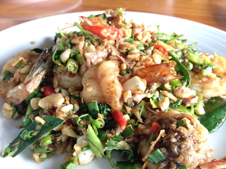 stir up: close up of Thai style stir fried shrimp with tropical herbs