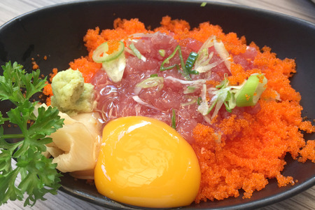 egg  yolk: Close up of the raw mince tuna with shrimp eggs serving with wasabi and fresh egg yolk
