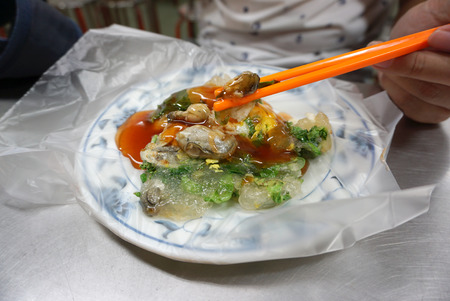 taiwanese: Fried oyster with bright orange chopstick Taiwanese style