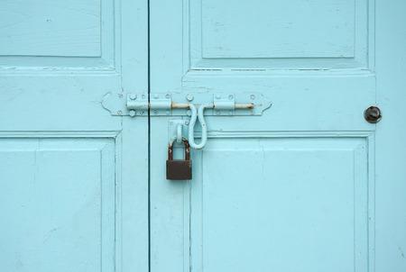 elevation: elevation of baby blue color timber door with rusty door lock