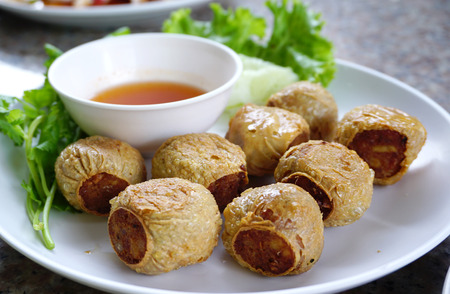 person appetizer: Deep fried crab meat rolls serving with plum sauces