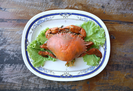 black giant: Streamed black giant crab in the plate on the table Stock Photo
