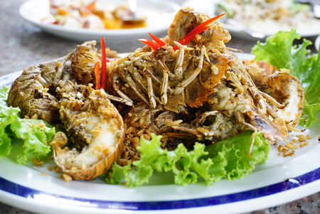 person appetizer: Deep fried crayfish with garlic