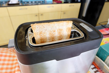 wheat toast: whole wheat toast in the toaster