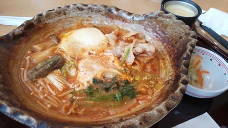 clay pot: Spicy kim chi soup with fresh tofu, pork and vegetable serving on the clay pot