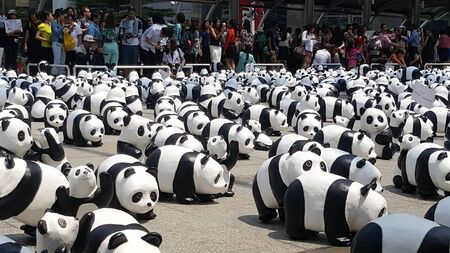 wwf: Bangkok, Thailand - March 8, 2016 : 1600 Pandas World Tour in Thailand by WWF at Chong Nonsi BTS skywalk bridge. 1600 paper marche pandas are made from recycled materials to represent 1600 pandas left in the wild.
