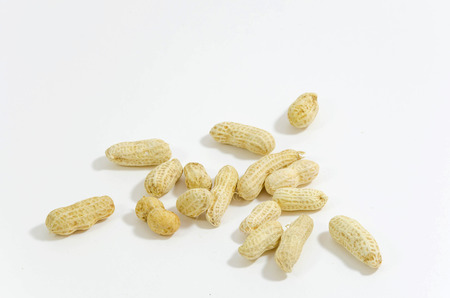 monkey nuts: peanut with shells on white background Stock Photo
