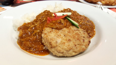 carte: close up of Pork burger with egg curry sauce on white rice Stock Photo