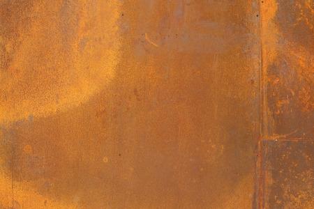 オレンジ色の Corten 鋼のテクスチャーと背景