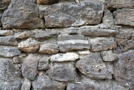 scabrous: Rough texture stone wall pattern and detail Stock Photo