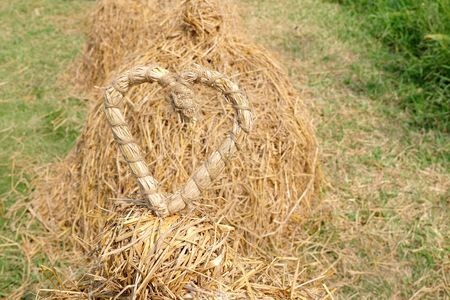 weaved: straw weaved in heart shape with nature background