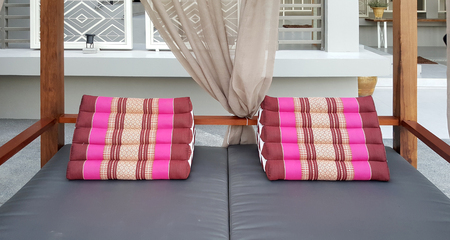 daybed: traditional Thai triangle pillow on the daybed ontdoor
