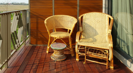 cane chair: wicker chair on the balcony outdoor with evening light Stock Photo