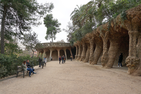 colonnaded: Barcelona, Spain - 12 December,2015 :  Beautiful slanted column structure support roof and Colonnaded footpath under the roadway viaduct at park guell on 12 December 2015 in Barcelona, Spain