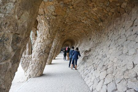 colonnaded: Barcelona, Spain - 12 December,2015 : Colonnaded pathway with slanted stone column at park guell, Barcelona, Spainl on 12 December 2015 in Barcelona, Spain