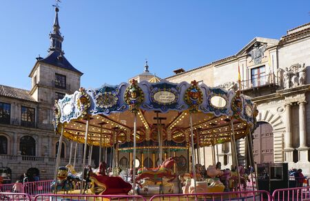 5 december: Toledo, Spain - 5 December,2015 : Merry go round at the square in Toledo, Spain on 5 December 2015 in Toledo, Spain