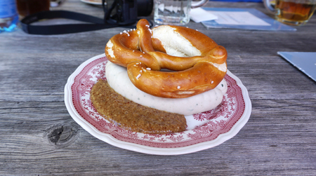 weisswurst: Weisswurst with homemade Pretzel on timber table