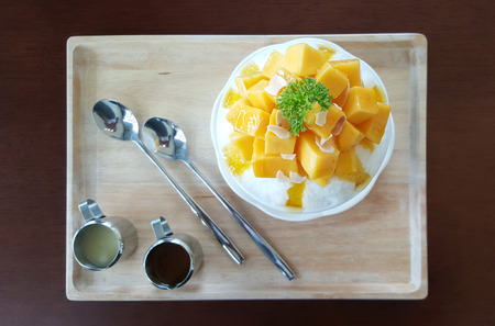 Mango with shaved ice milk flavour serving with syrub Stock fotó