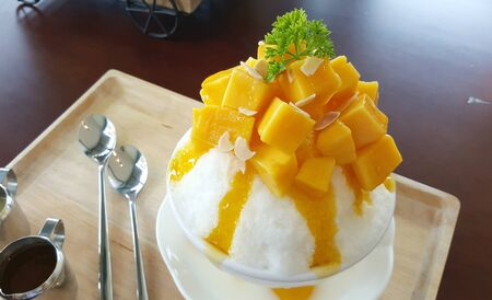 shaved: Mango with shaved ice milk flavour serving with syrub