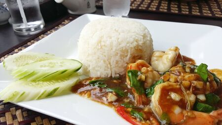 jasmine rice: Stir fried shrimp with basil and oyster sauce seving with jasmine rice