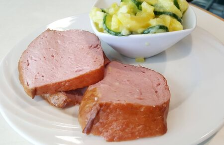 meatloaf: meatloaf serving with potato salad on white plate