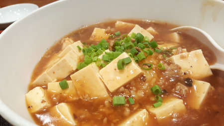 beancurd: Japanese style tofu and minced pork with spicy sauce on white bowl