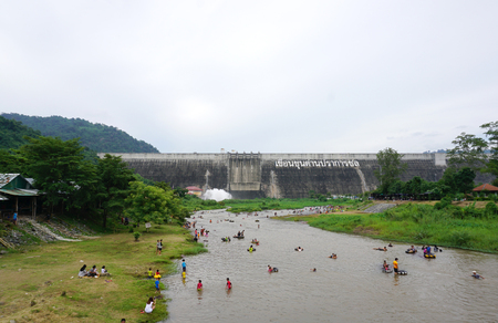 Nakhon Nayok, Thailand - 18 July,2016 : local people playing in the water that come from Khun dan prakan chon dam the famous landmark of Nakhon Nayok on 18 July 2016 in Nakhon Nayok, Thailand Editorial