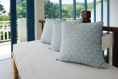 throw cushion: Generic blue pattern pillow isolated on bench indoor Stock Photo