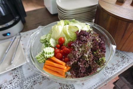 glass bowl: fresh vegetable for salad in glass bowl  on the table