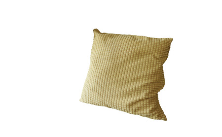 throw cushion: Generic yellow pattern pillow on armchair with white background Stock Photo