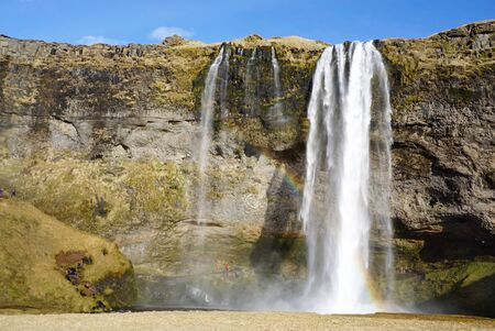prairie: Beautiful  Seljalandsfoss waterfall with river and meadow  in Iceland Stock Photo