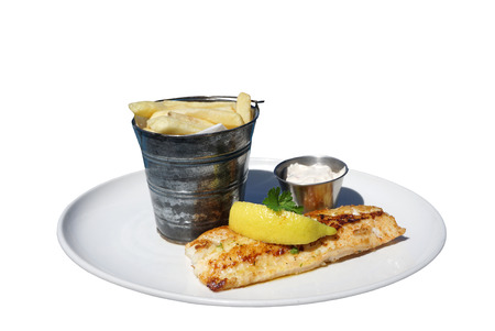 whitw: grilled sea bass serving with french fried on the bucket with white background