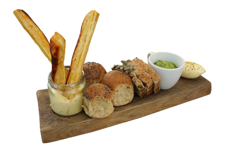 Cereal Bread and Breadstick with dipping sauce serving on timber block isolated with white background