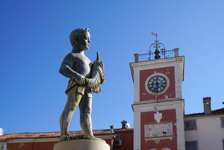 Rovinj, Croatia - 8 April ,2017 : Boy with the fish Fountain on Main Square in Rovinj on 8 April 2017 in Rovinj, Croatia