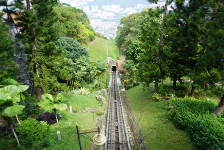 Looking down to Penang hill cable car rail surrounding with tropical plants Stock Photo