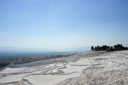 Panoramic view of the beautiful white Travertines terrace of Pamukkale landscape without water in July Stock Photo