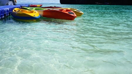 Beautiful beach with colorful kayak on the water outdoor