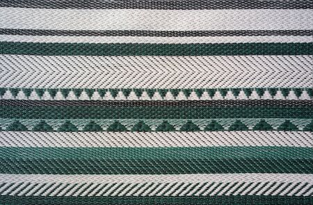 Green and white stripe plastic woven mat texture and pattern 版權商用圖片