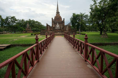Bridge to Buddha Pagoda at Sukhothai Historical Park, Thailand Stock Photo