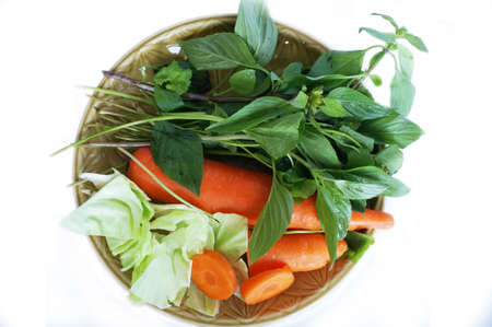 Vegatables set - diet food for health - green sweet basil ( Thai basil ), white cabbages and orange carrots isolated on white background
