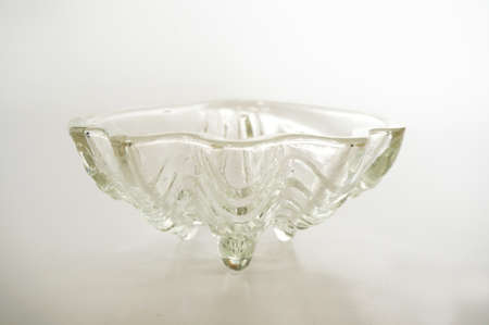showpiece: Crystal transparent utensils or crystal bowl, glass bowl, isolated on white background, close up Stock Photo