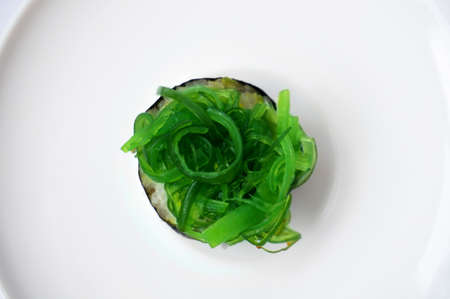 Asia - Asian eating food, Japanese food, seaweed sushi isolated on white background. Stock Photo