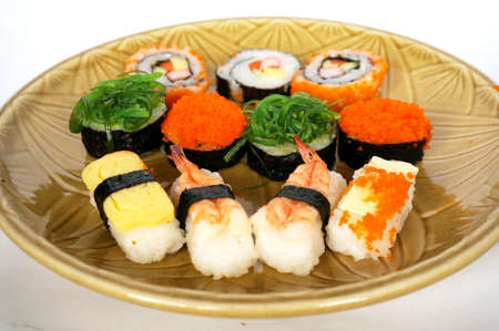 Asia - Asian eating food, Japanese food, sushi set on plate isolated on white background. Stock Photo