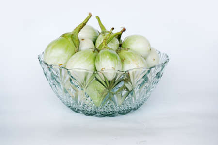 nightshade: Close up of photo of very fresh green Thai eggplant or Yellow berried nightshade  ( Solanum virginianum L. , Chionathus parkinonii of family SOLANACEAE ) in crystal glass bowl isolated on white background Stock Photo