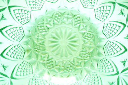 showpiece: Texture of flower lattice pattern on crystal transparent utensils or crystal bowl, glass bowl, green color, isolated on white background, close up