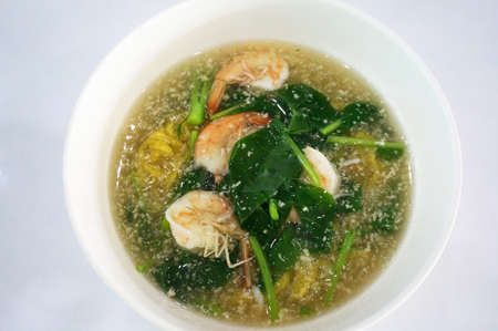 Asia - Asian eating food, Thai food, a Noodles in Thick Gravy with Seafood, close up