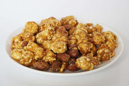 Caramel popcorn on white plate isolated on white background Stock Photo