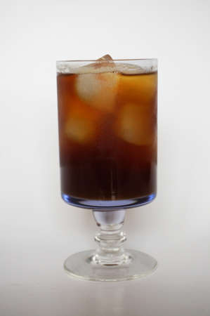Cola, black coffee, on champagne glass on white plate isolated on white background, close up Stock Photo