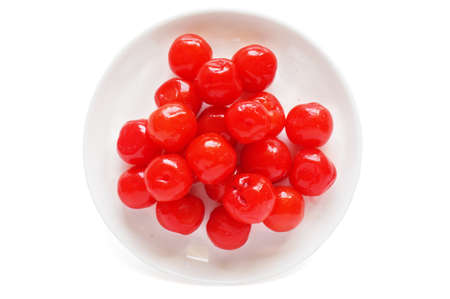 A photo of Maraschino cherries on a white plate isolated on white background, close up Stock Photo
