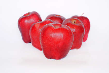 Close up of photo of very fresh red apples isolated on white background